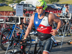 JGT Participant running out of transition with his bike in hand