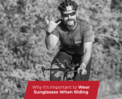 Cyclist wears sunglasses during the bike portion of Jack's Generic Triathlon. Text on design reads Why It's Important to Wear Sunglasses When Riding. Learn more at https://jacksgenerictri.com/2020/11/wear-sunglasses-when-riding/