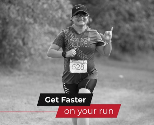 Runner smiles and waves for the camera during the run portion of Jack's Generic Triathlon. Text on design reads Get Faster on Your Run. Learn more at https://jacksgenerictri.com/2020/12/get-faster-on-your-run/